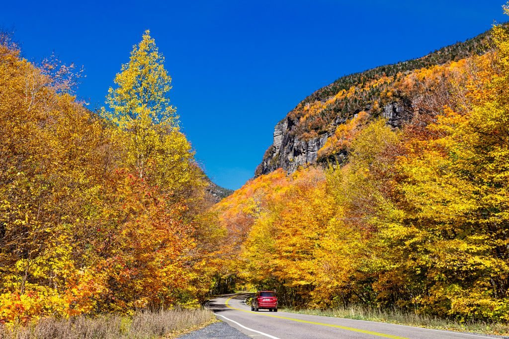 Scenic autumn drive through Smugglers Notch State Park...