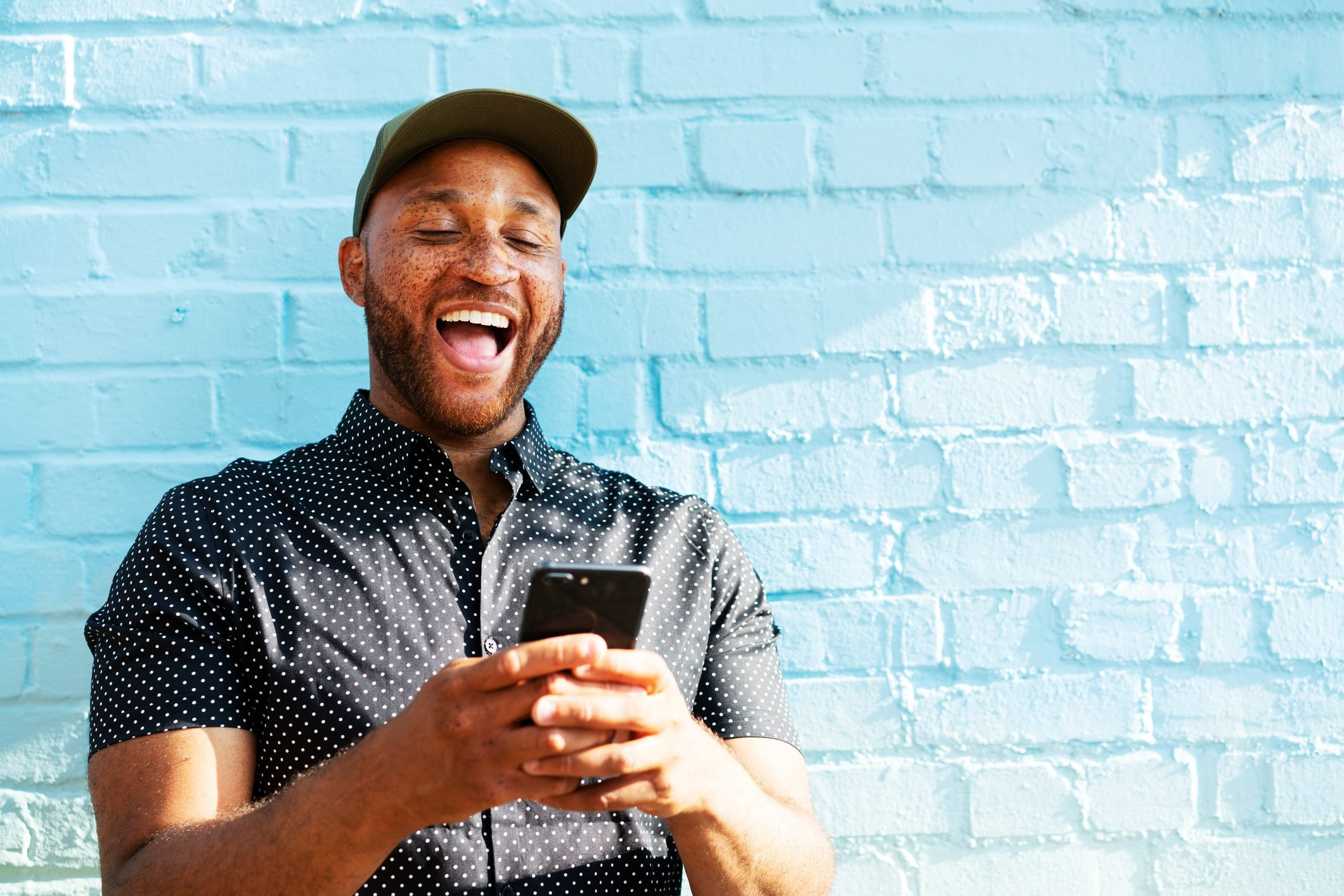 Man laughing with smart phone