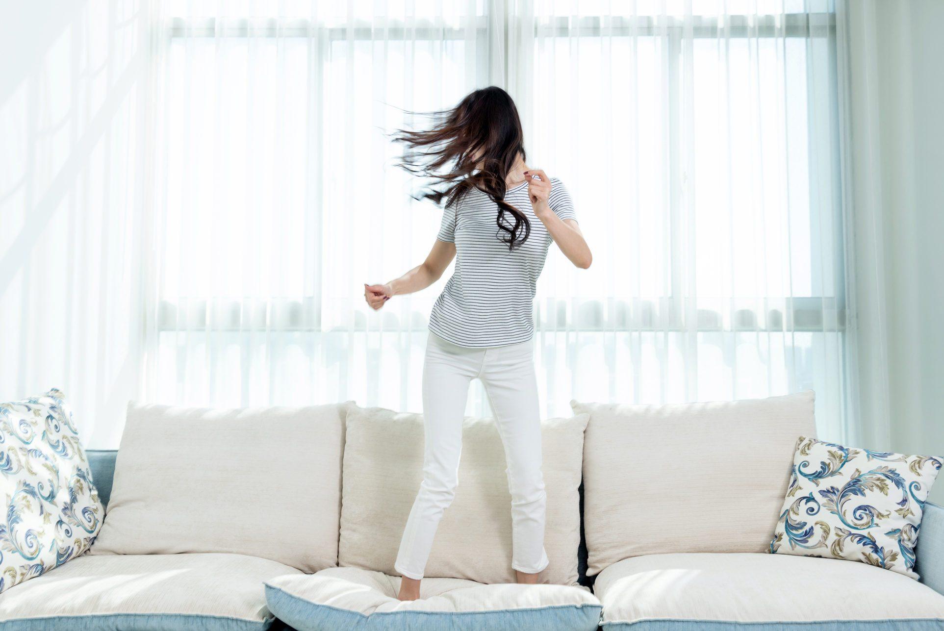 Woman dancing on the sofa