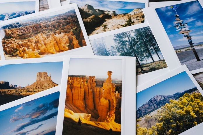 Collection of instant travel holiday photos on a table