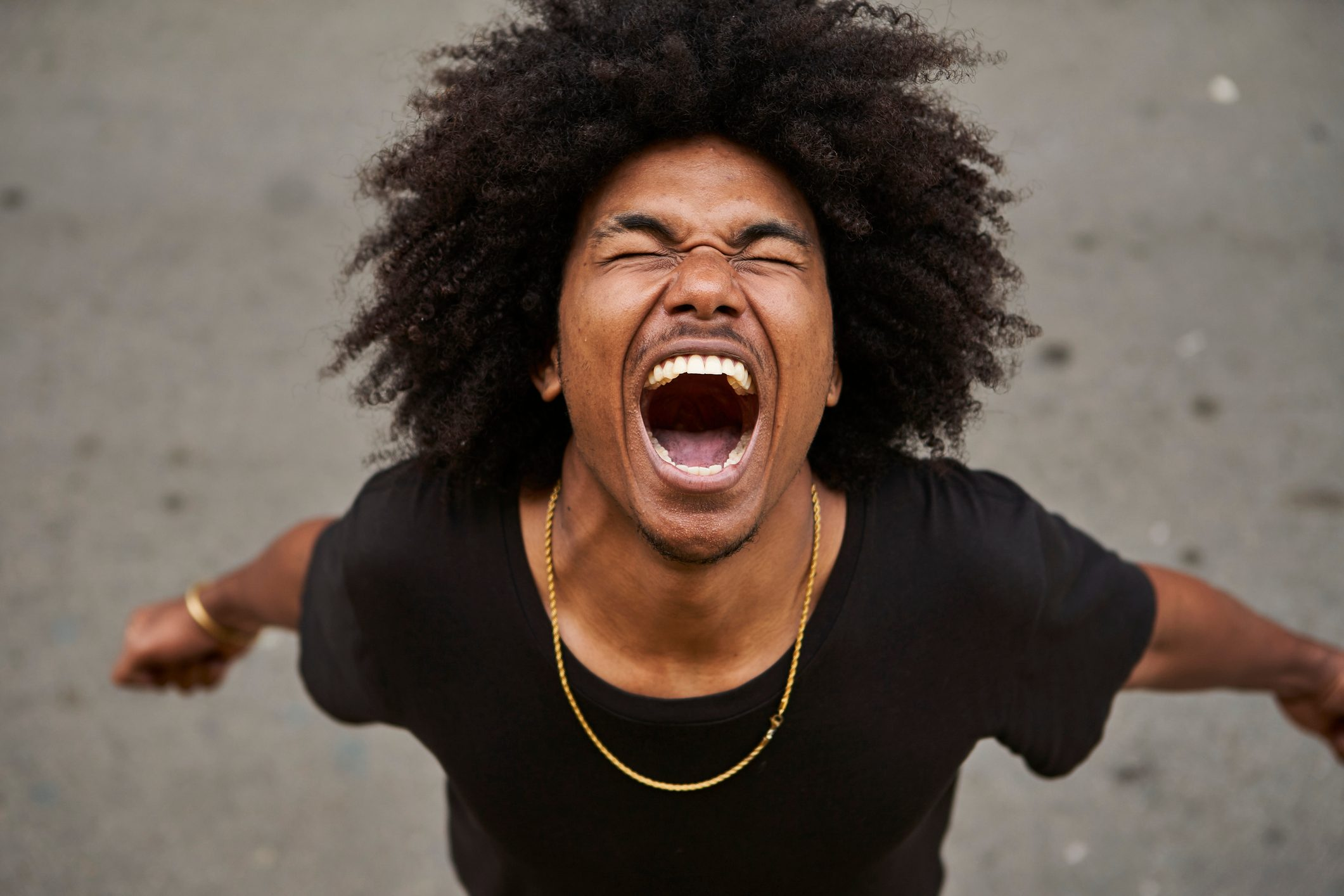 Portrait of screaming young man with afro