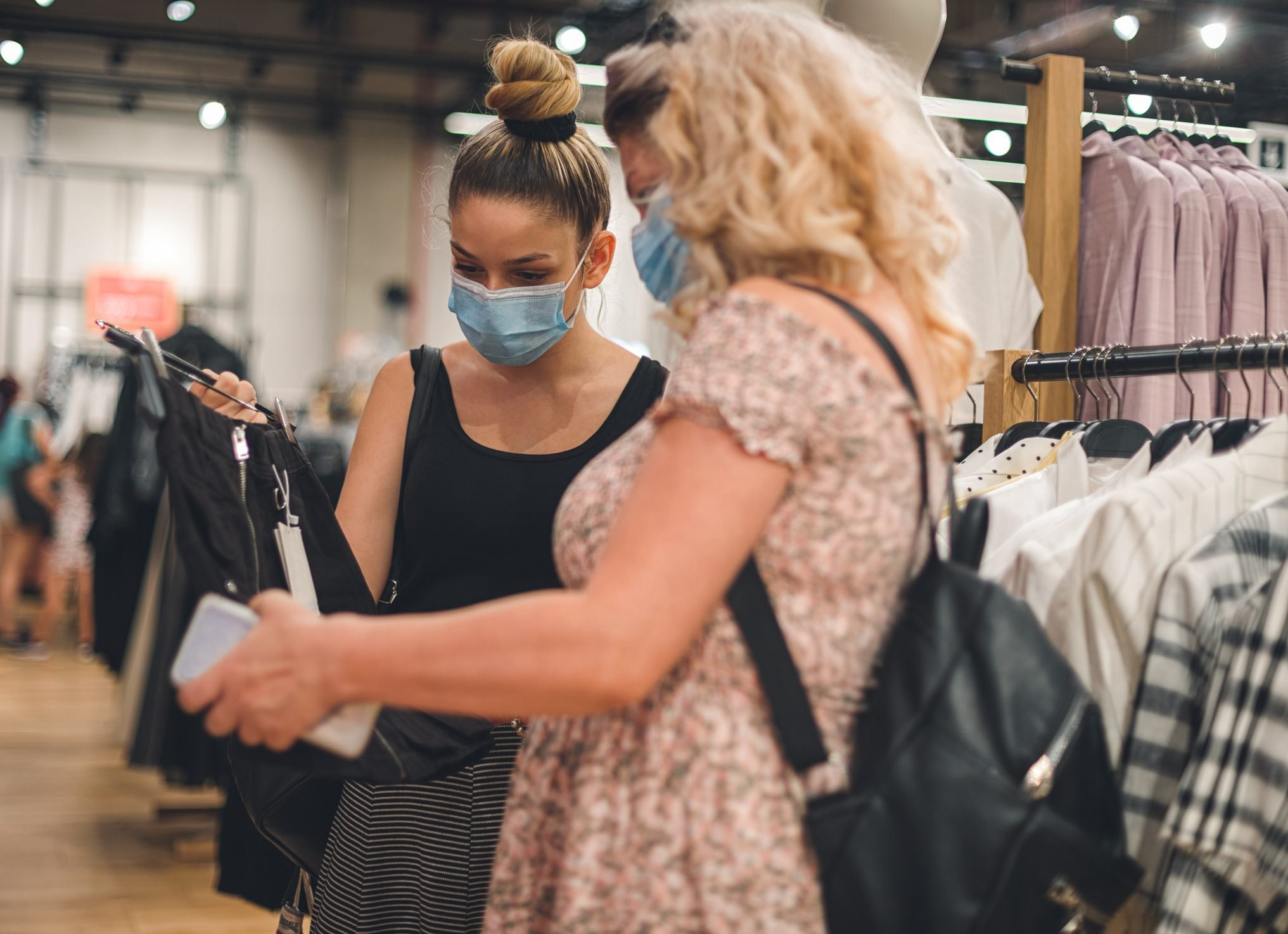 Family shopping at the mall during COVID-19 pandemic. They wears a protective mask to protect from coronavirus COVID-19.