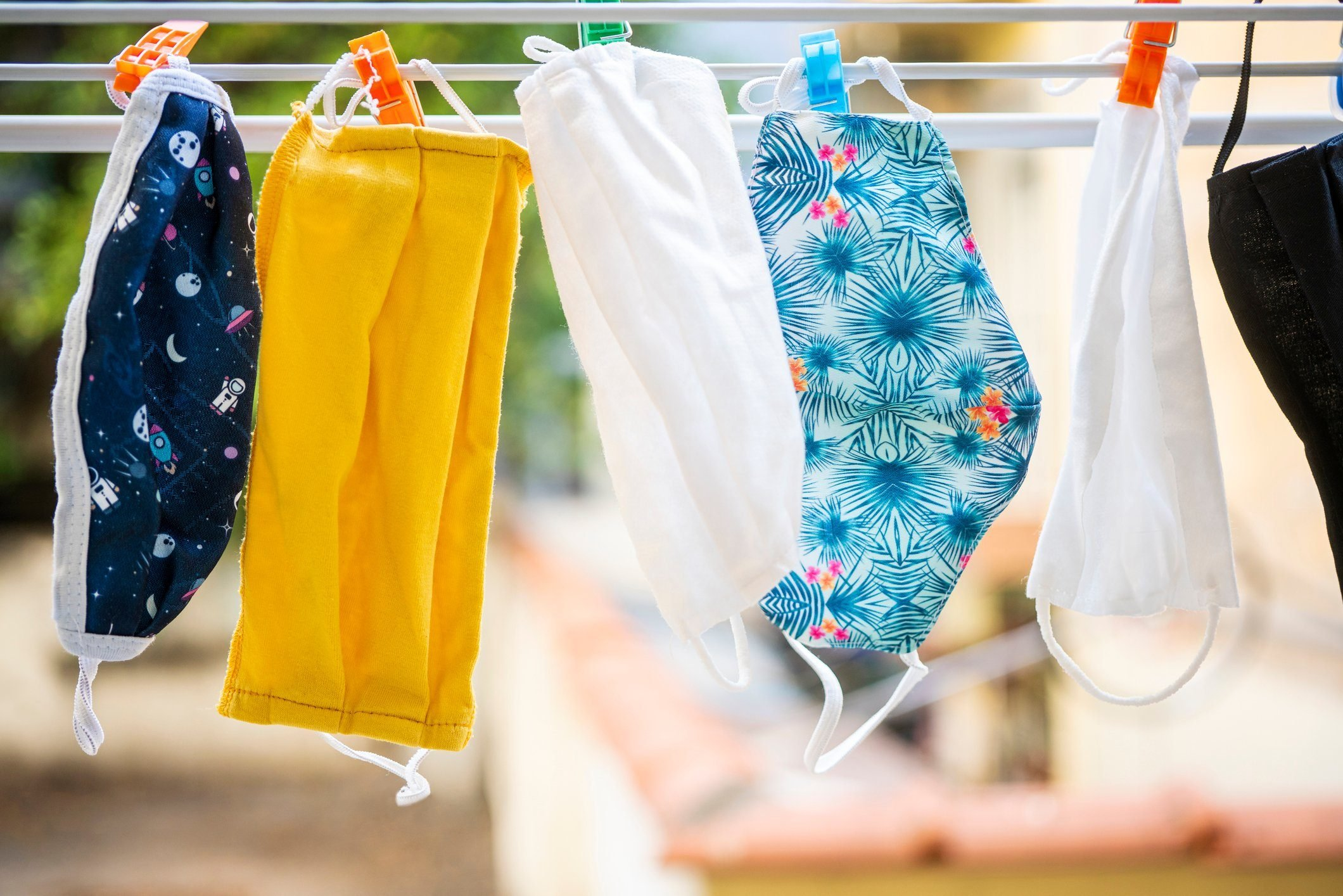 Face masks drying on air hang up on a leash