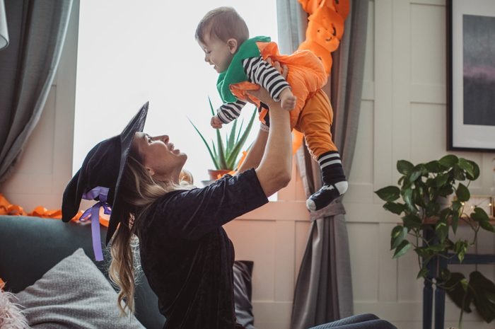 Mother and baby playing on Halloween