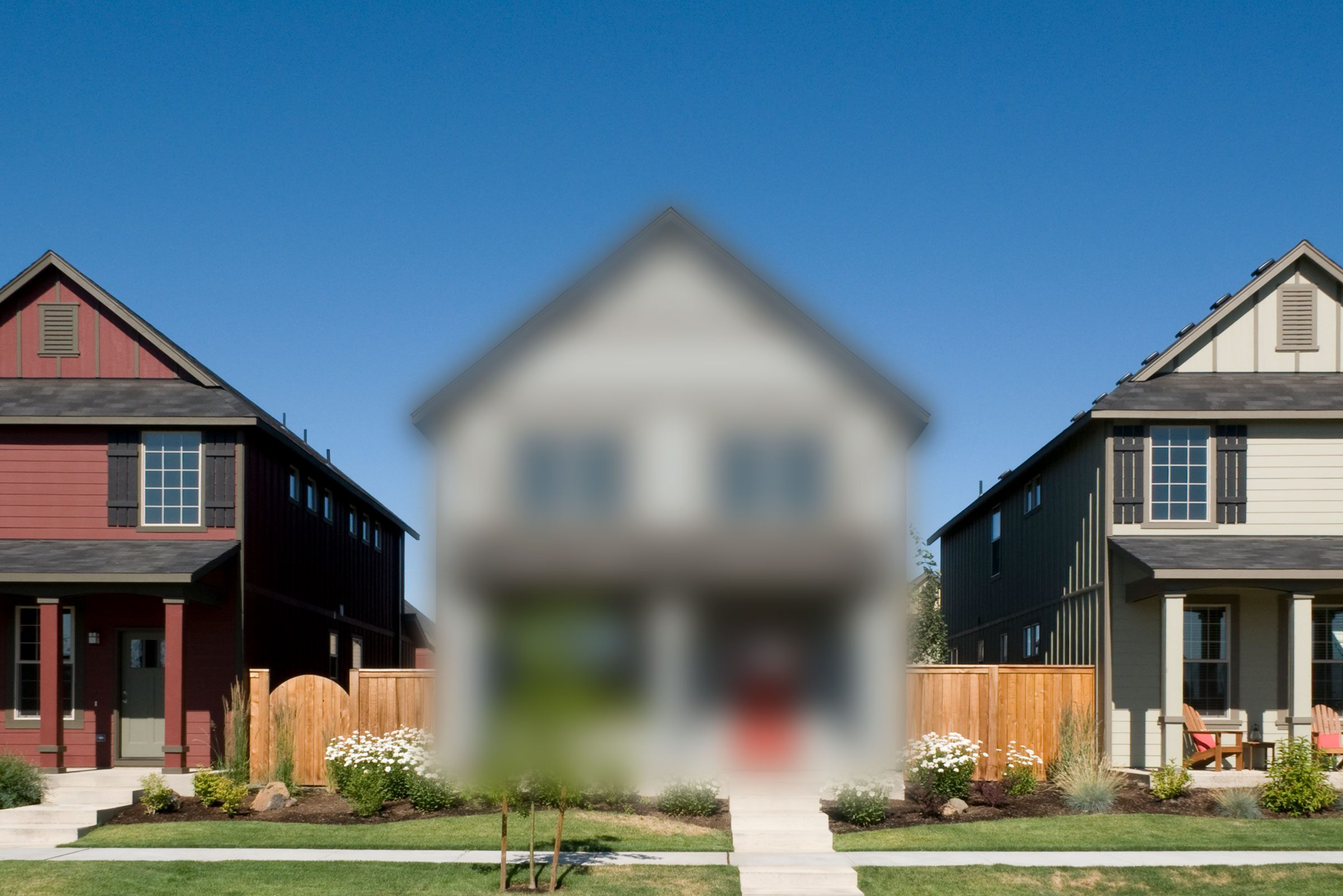 row of houses with center house blurred