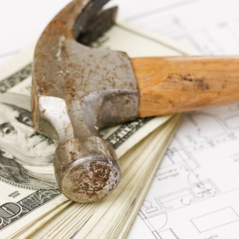 Hammer and Money on Blueprints