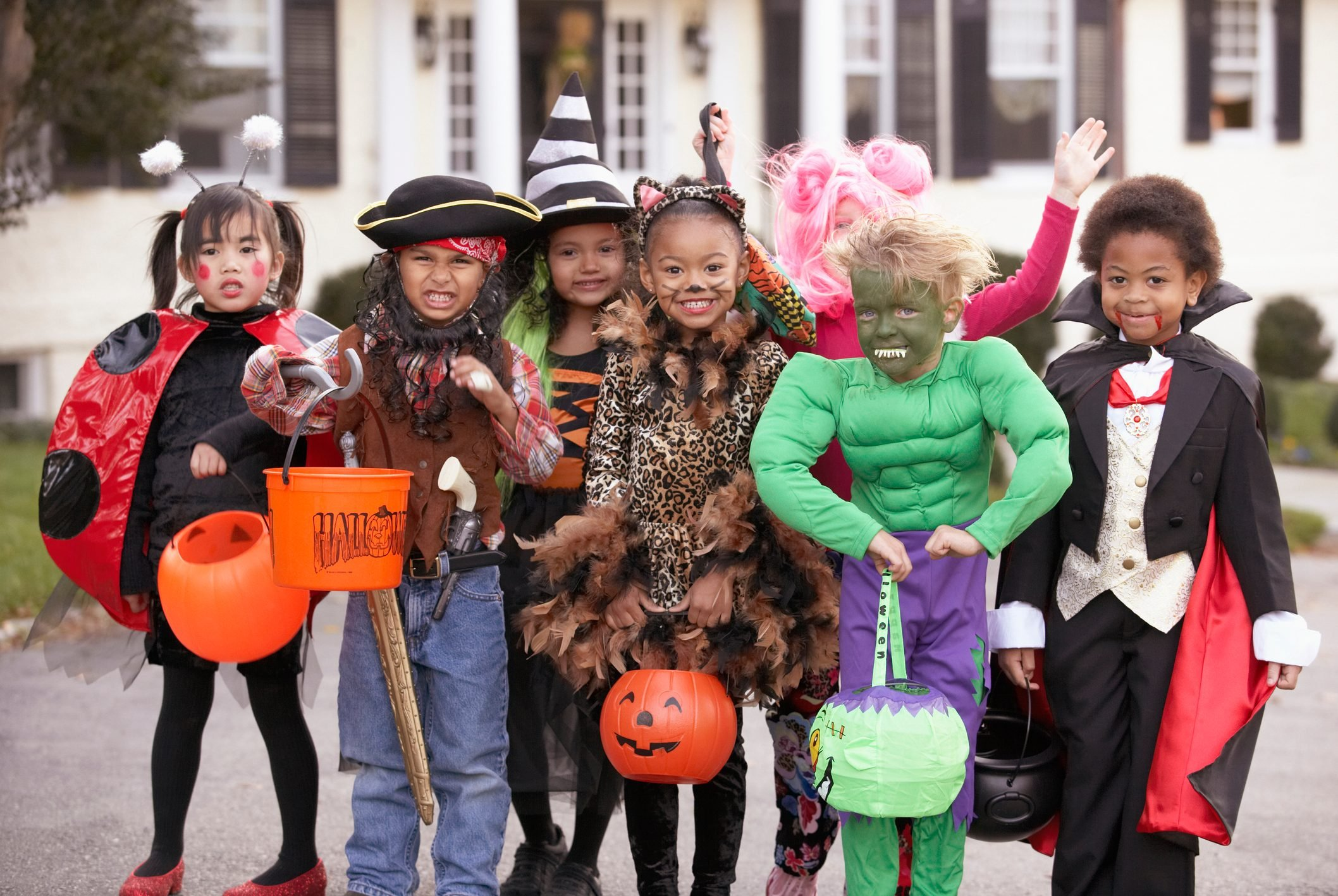 Children (4-7) dressed up for Halloween, group portrait
