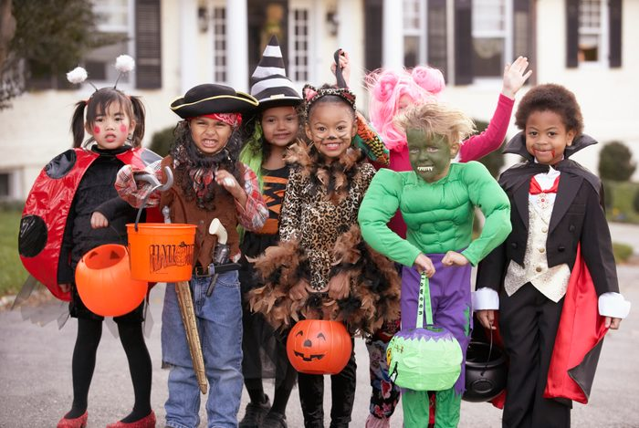Children (4-7) dressed up for Halloween, group portrait