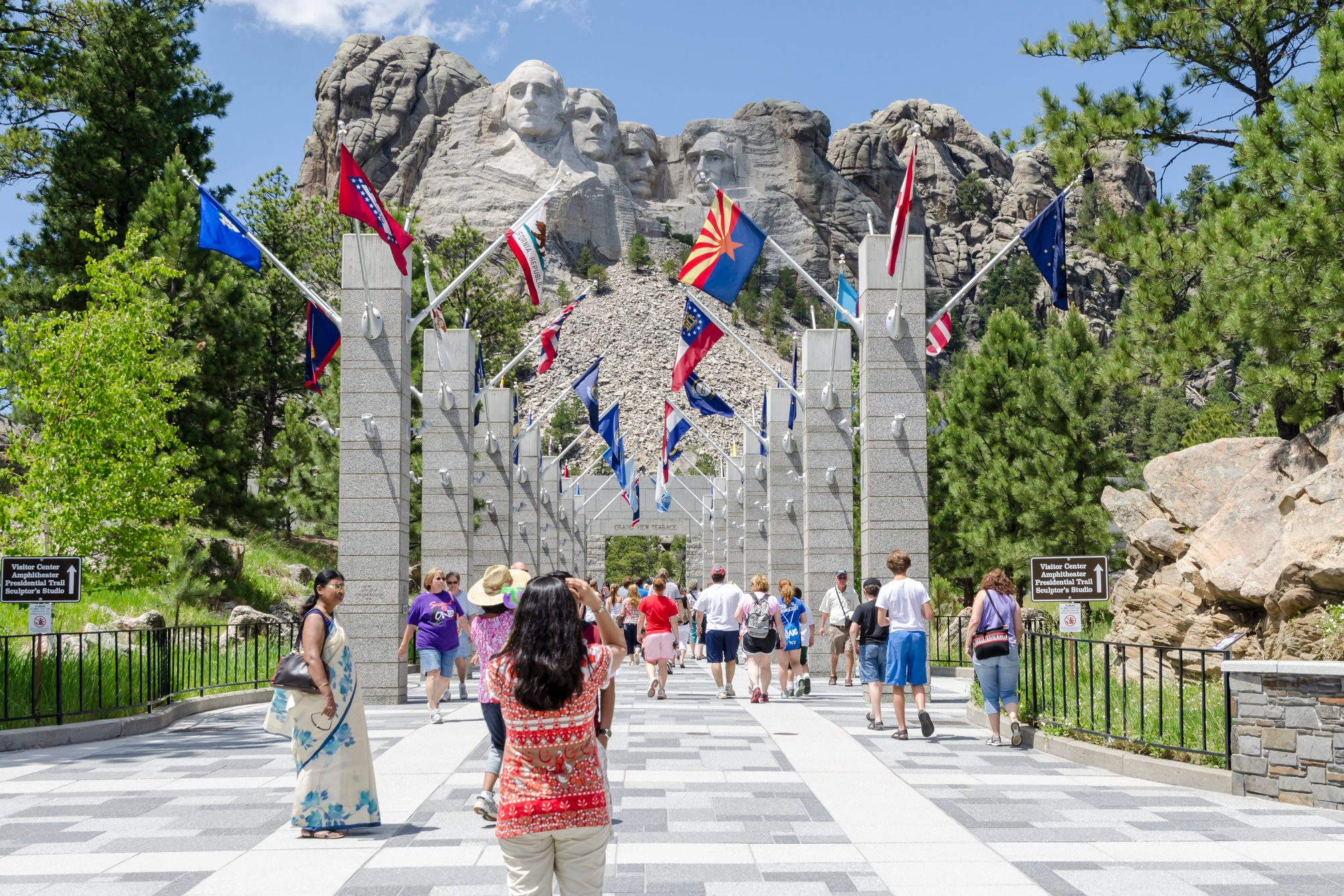 Visitors at Mount Rushmore Avenue of Flags.