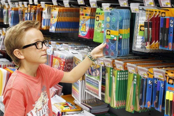 Child Getting School Supplies