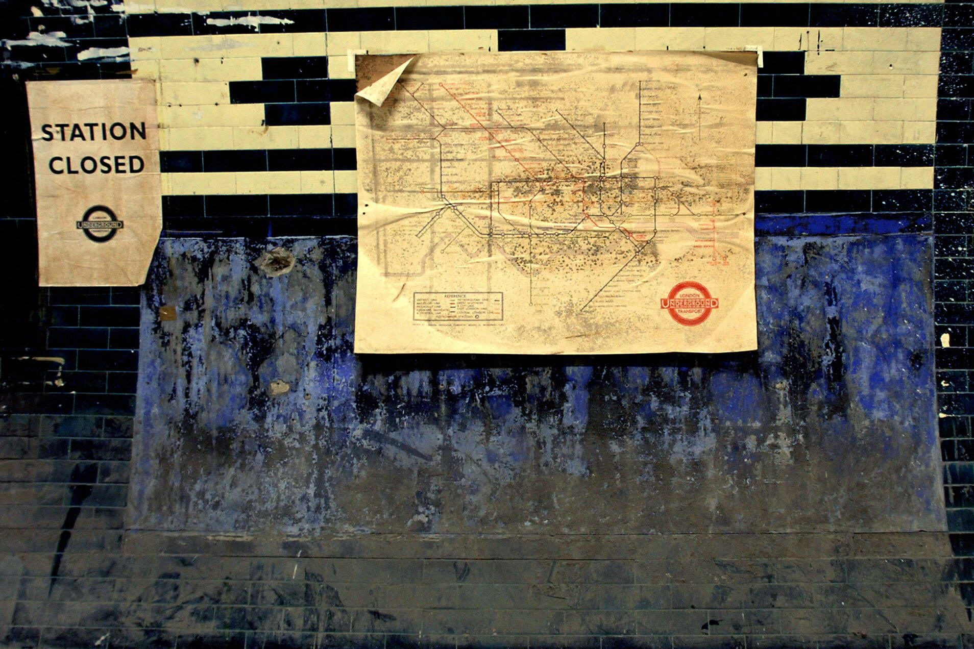 """An old subway map and """"station closed"""" s"""
