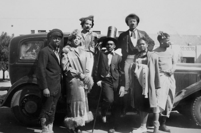 Group of young men and women ready for a costume party, ca. 1930.