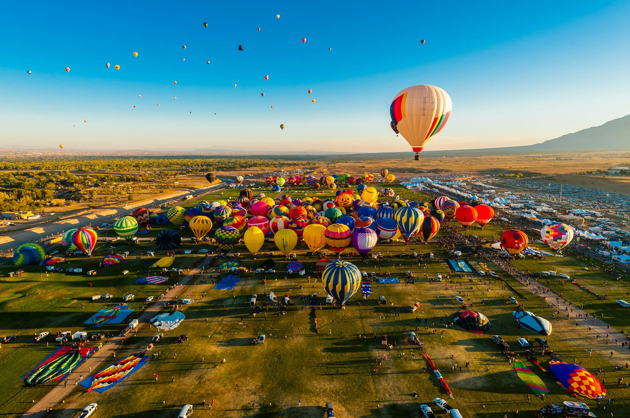 Aerial view, Hot air balloons lifting off from Balloon Fiesta Park,