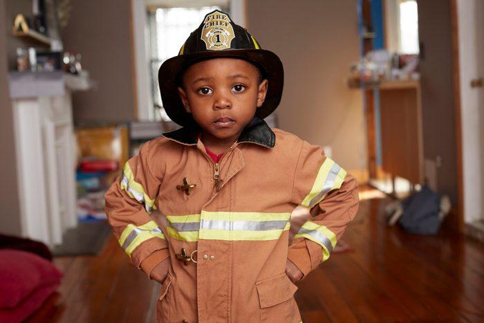 Black boy wearing firefighter Halloween costume