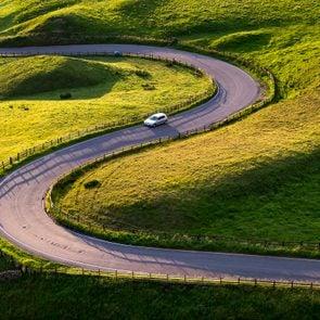 Car on a twisty, winding road