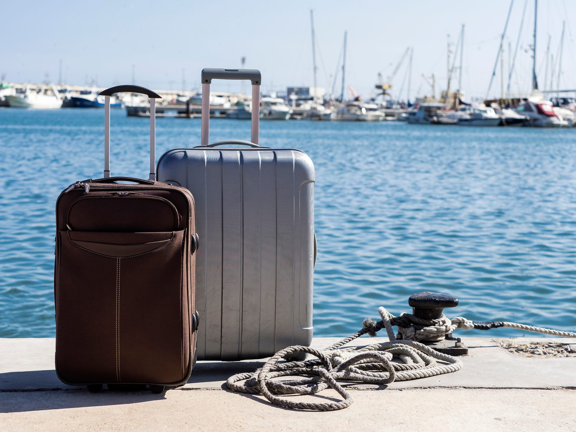 Suitcases prepared next to a pier at sea to board a passenger ship
