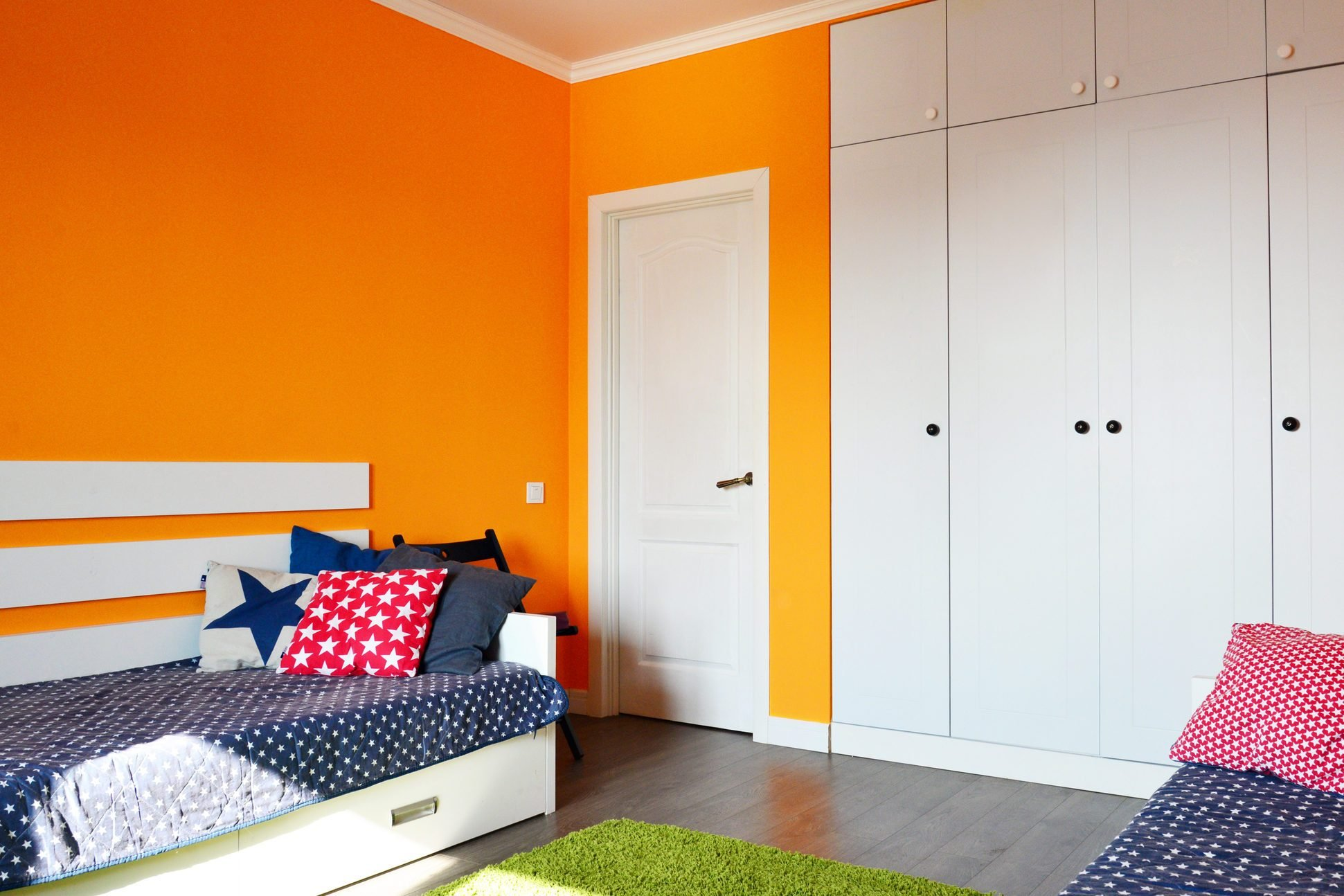 Kids bedroom in orange and blue colors