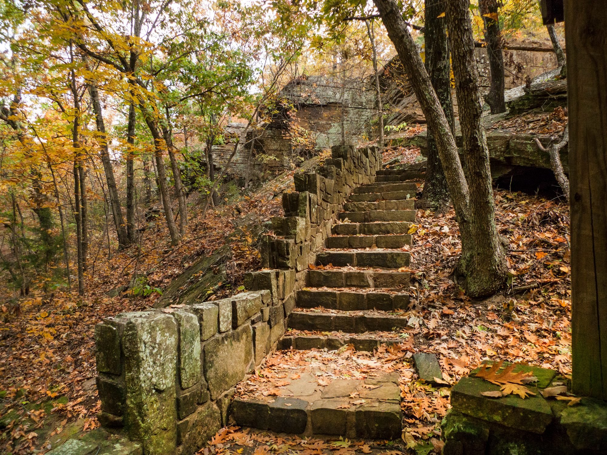 Mysterious stone staircase in an autumn forest