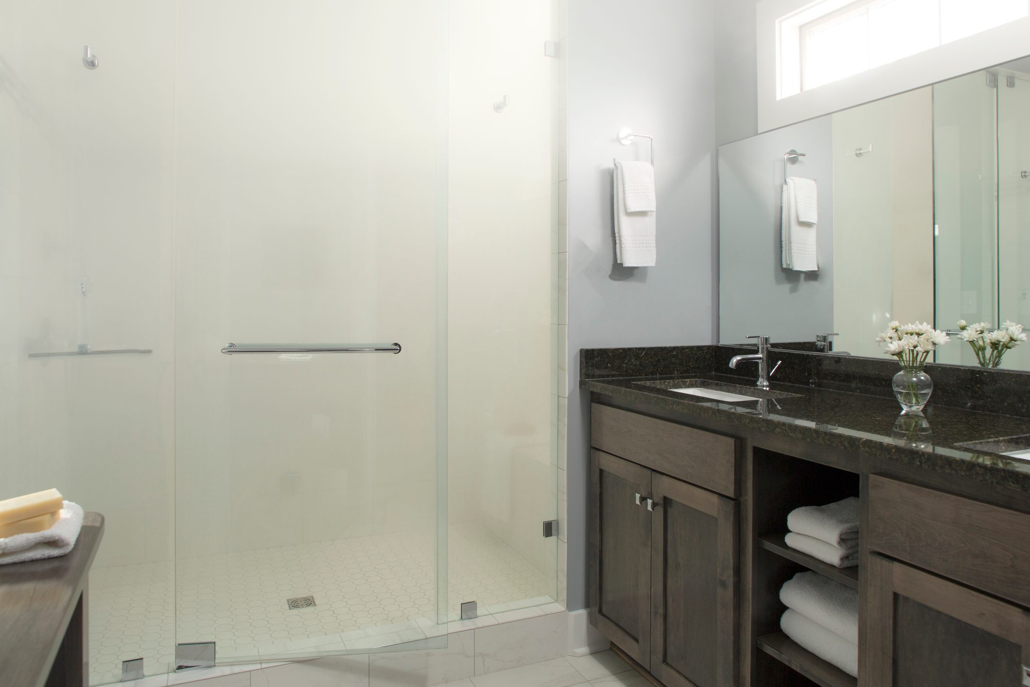 Tiled Modern Bathroom with Glass Shower Doors and steam shower