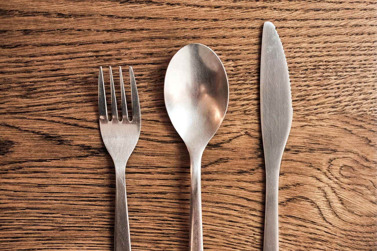 Directly Above Shot Of Eating Utensils On Table