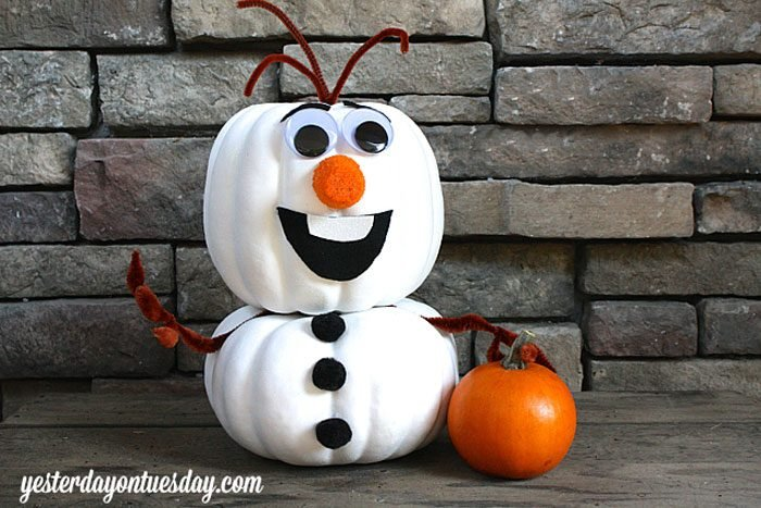 two pumpkins painted and stacked to look like Olaf the snowman from Disneys Frozen