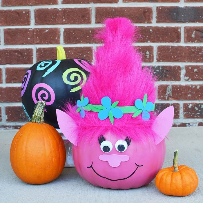 pumpkin painted to look like a troll with added ears and hairstyle