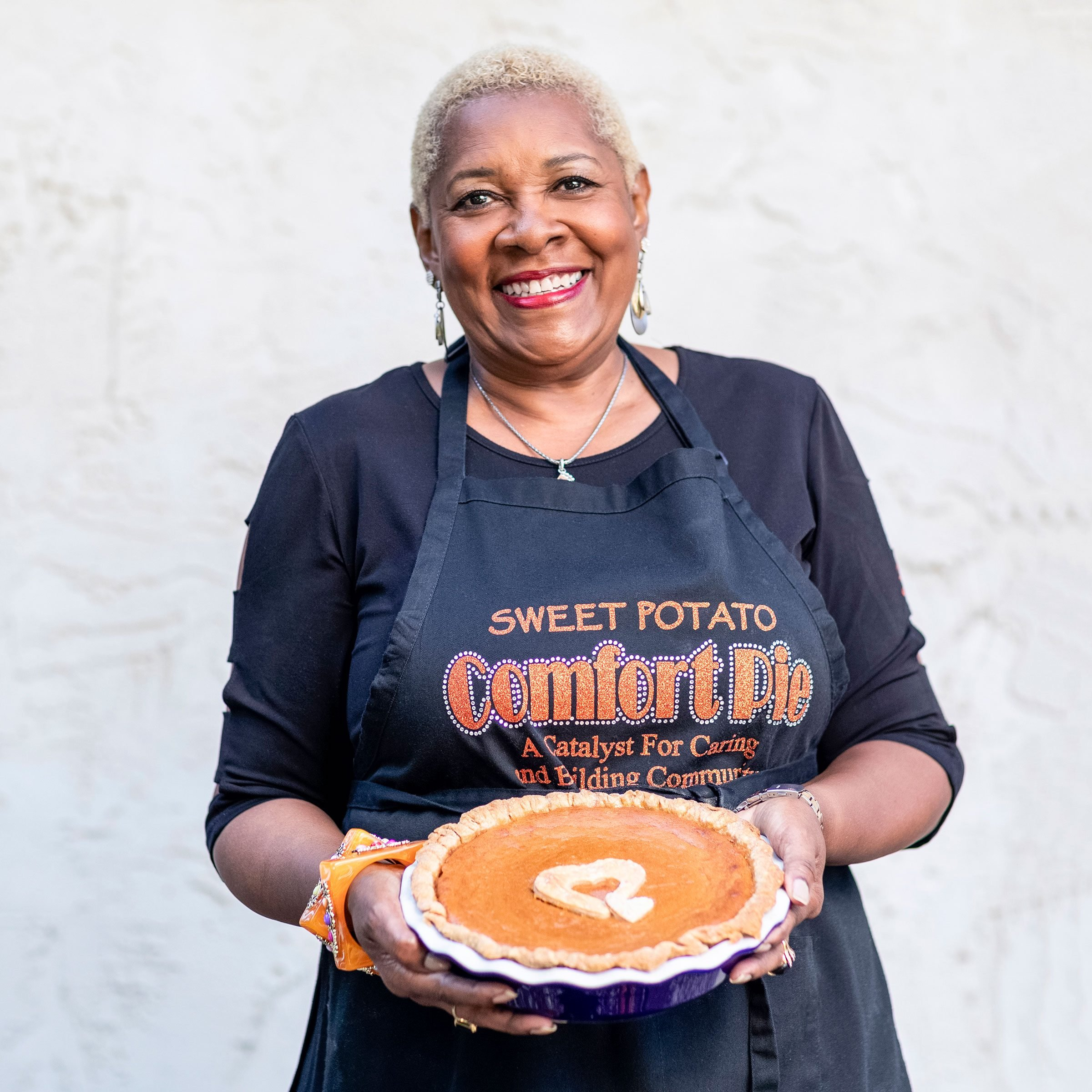 Rose McGee holding one of her pies