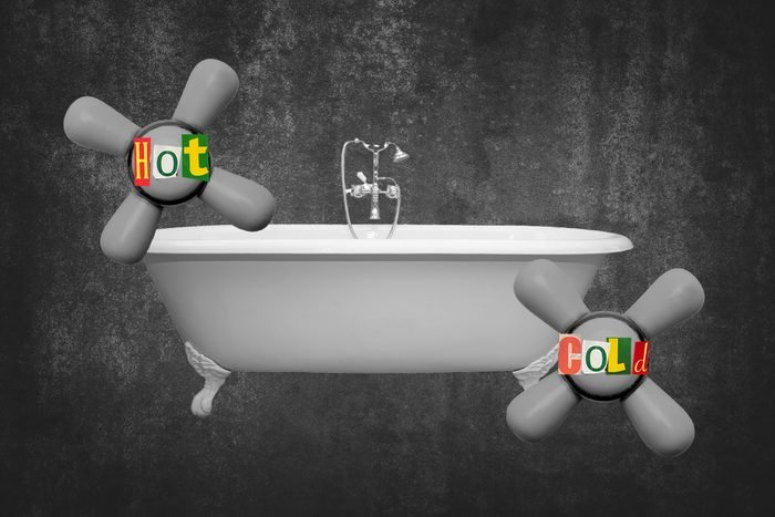 Bathtub With Enlarged Temperature Knobs Labeled Hot And Cold