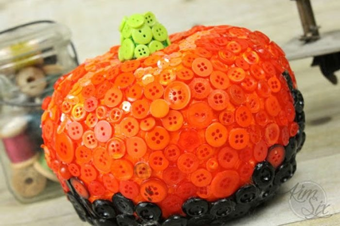 pumpkin decorated by being completely covered by buttons
