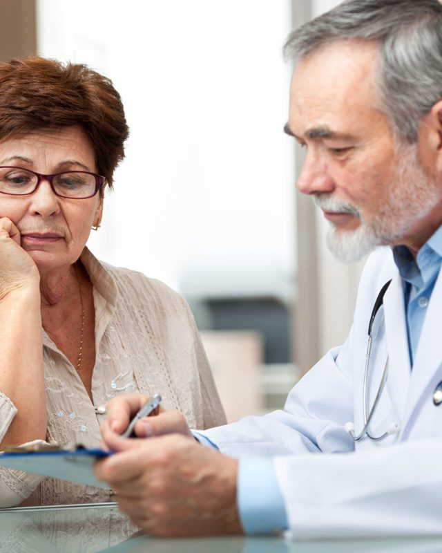 Doctor explaining results to elderly patient