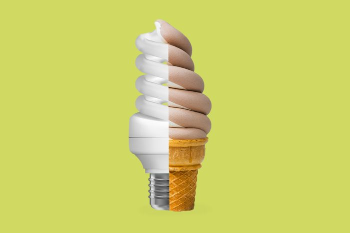 light bulb and ice cream cone fused together on green