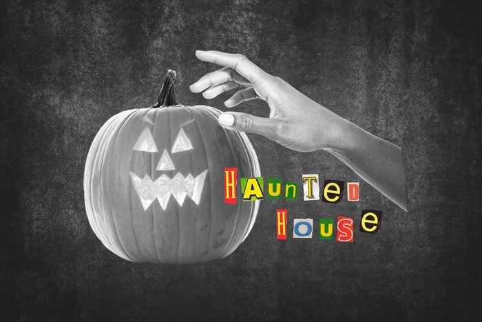 Jack O Lantern And Outreached Hand With Text Haunted House