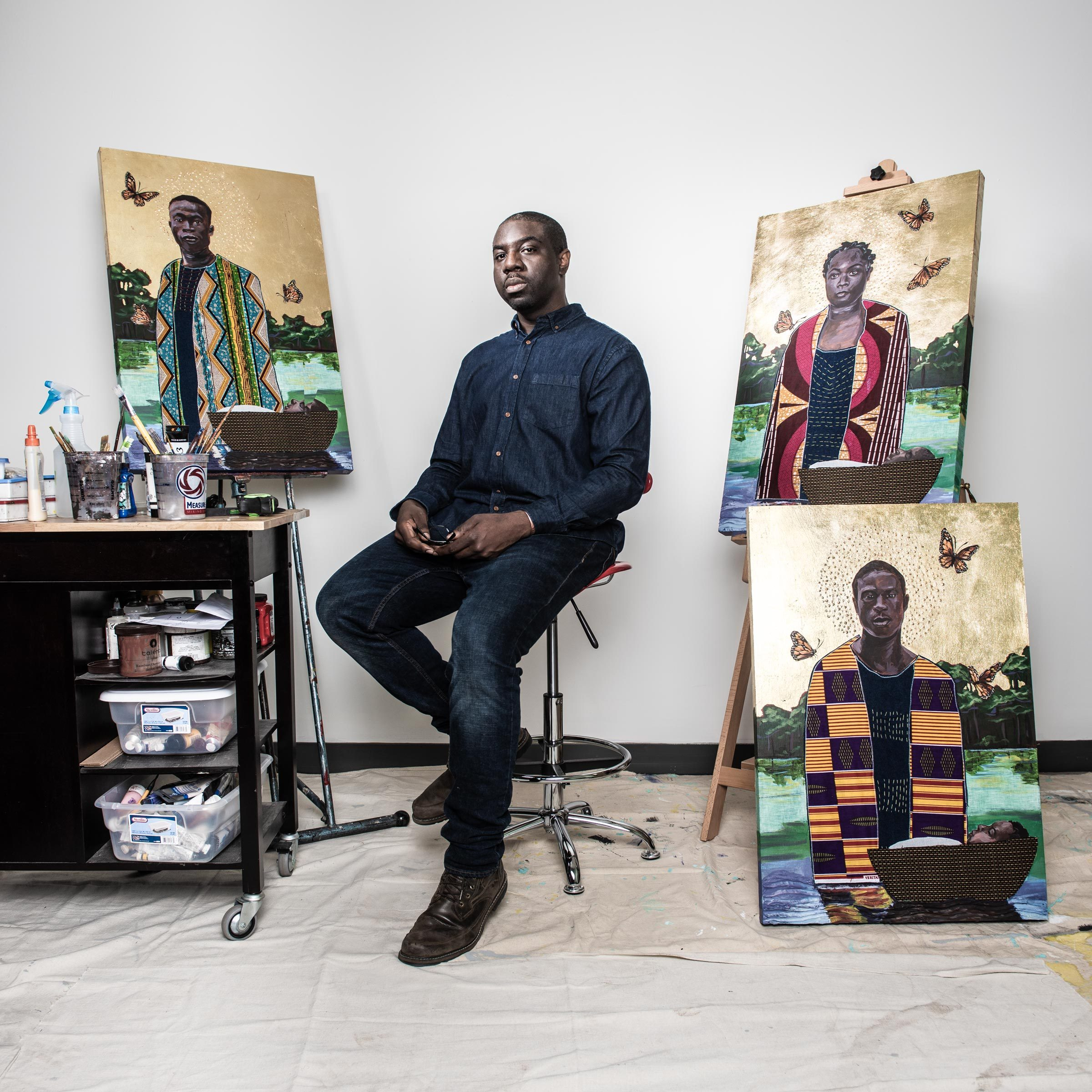 artist Stephen Towns poses with some of his paintings