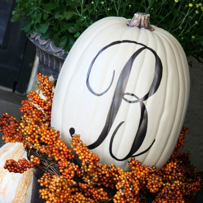 pumpkin painted with a monogram design