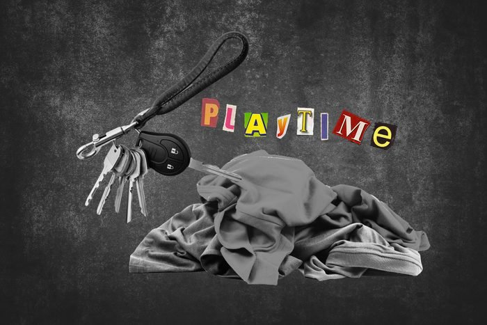 Pile Of Clothing Next To Key Ring With Text Playtime