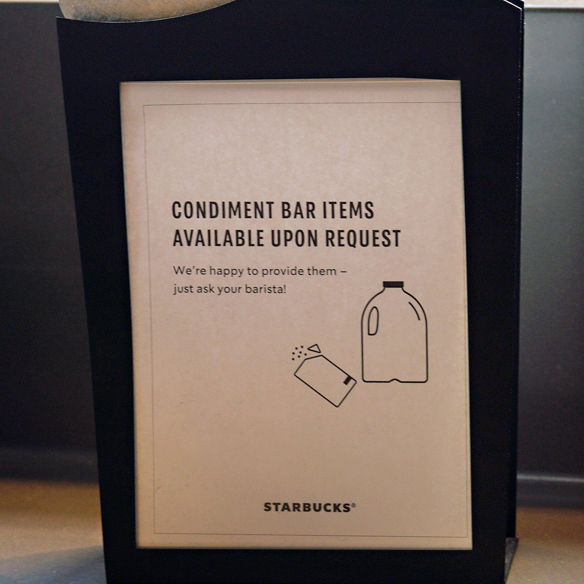 NEW YORK, NY - MARCH 14: A sign is on display at Starbucks offering condiment bar items on request rather then self serve as the coronavirus continues to spread across the United States on March 14, 2020 in New York City. The World Health Organization declared coronavirus (COVID-19) a global pandemic on March 11th. (Photo by Cindy Ord/Getty Images)