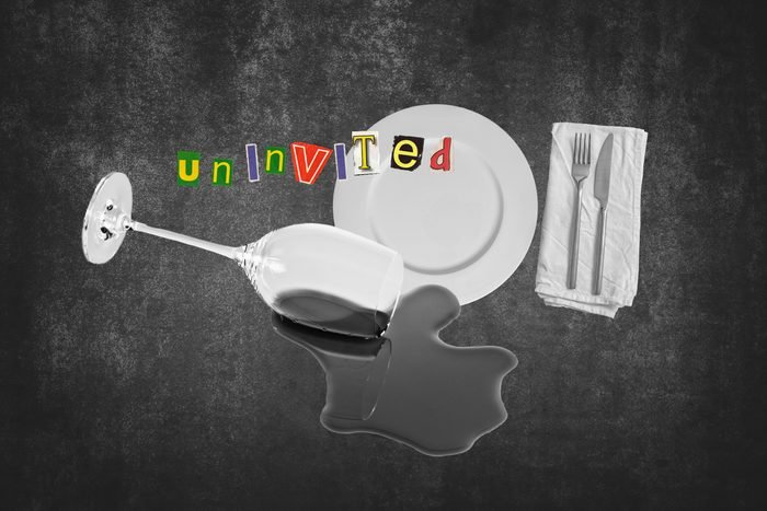 Spilled Wine Glass Next To Placemat Setting With Text Uninvited
