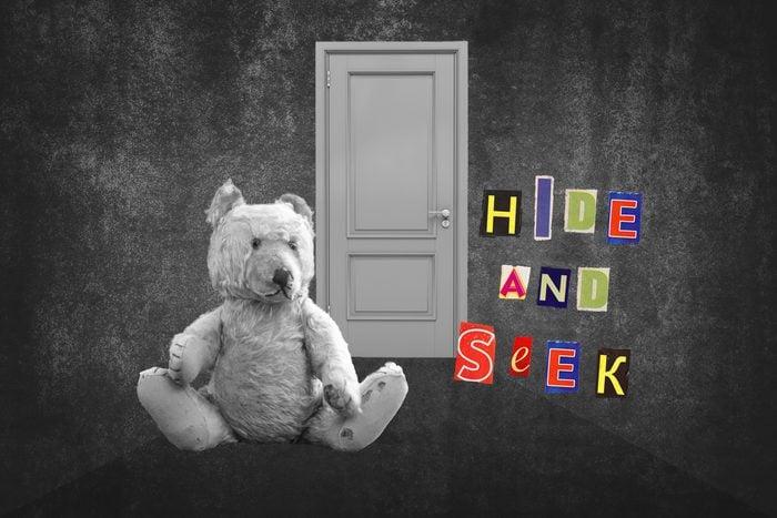 Teddy Bear Sitting In Hallway With Text Hide And Seek