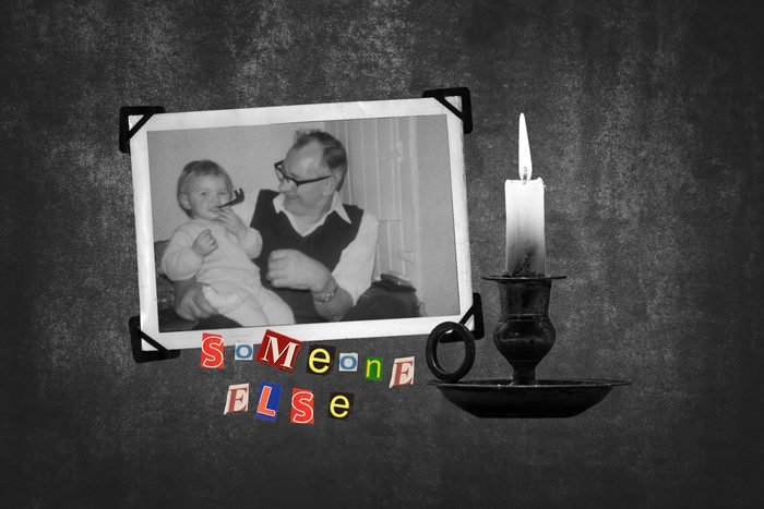 Vintage Photograph Of Grandfather And Baby Next To Candle With Text Someone Else
