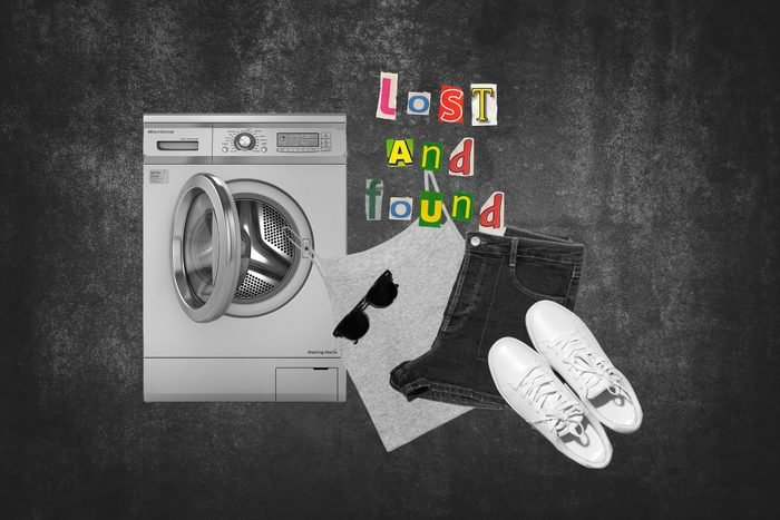 Washing Machine With Set Of Clothes Next To Text Lost And Found
