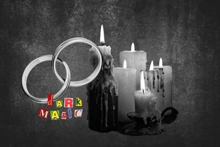 Wedding Bands Next To Candles With Text Dark Magic