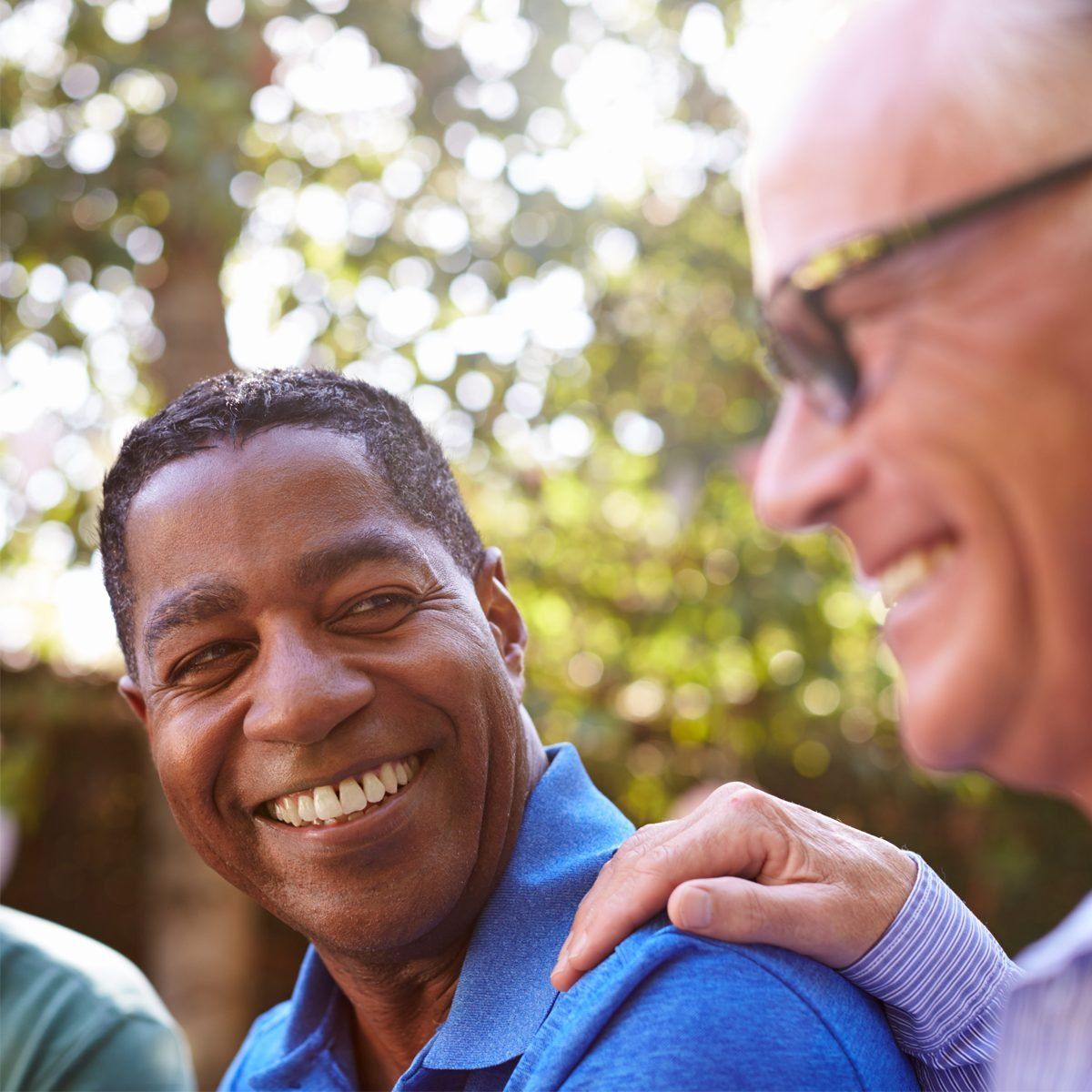 Mature Male Friends Socializing In Backyard Together; Shutterstock ID 583329769; Requestor Name: Morgan Beard; Requesting Department: Brand; Project Name/ Description: Photo Library; Use: Internal/External/Both: Both