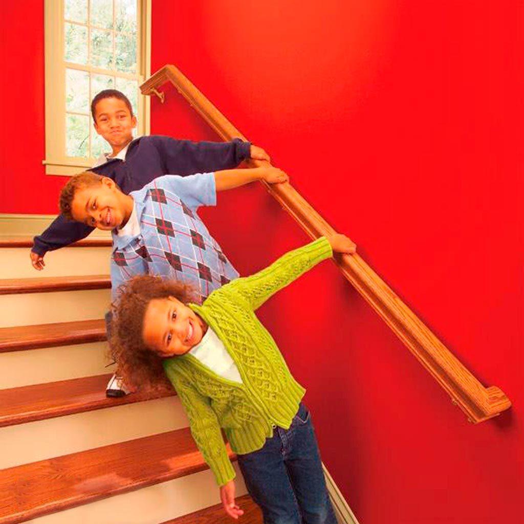 kids pulling on stair railing
