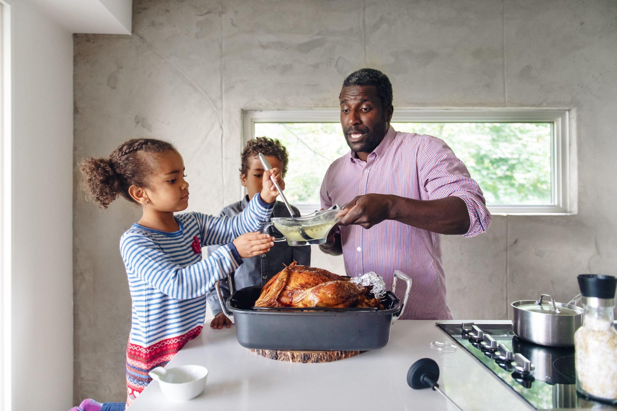Fathers preparing thanksgiving turkey
