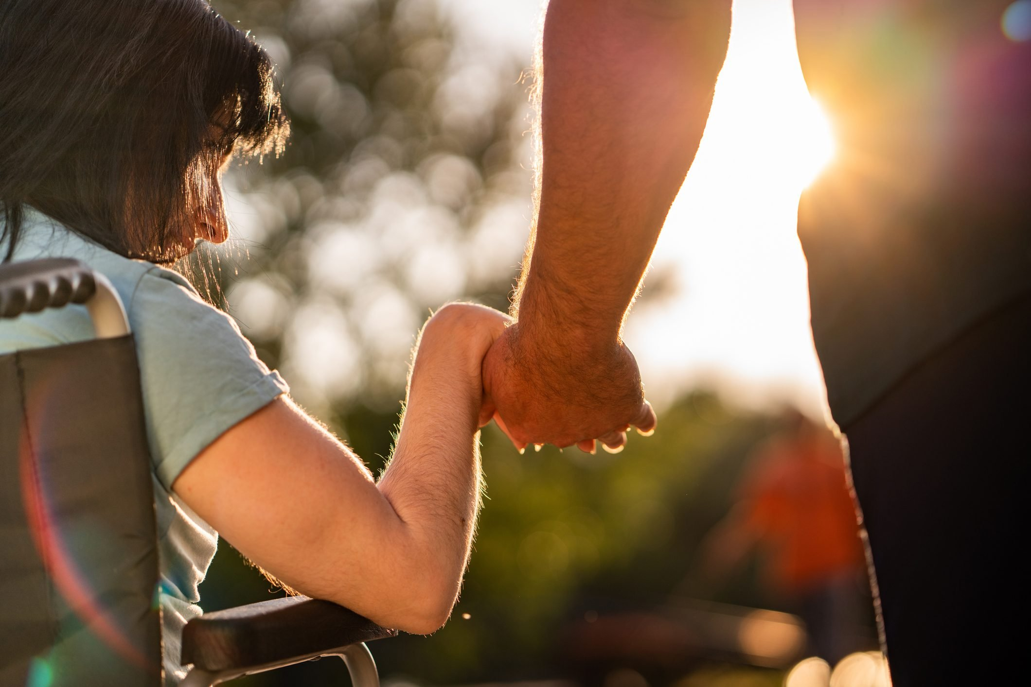 Couple hands during sunset
