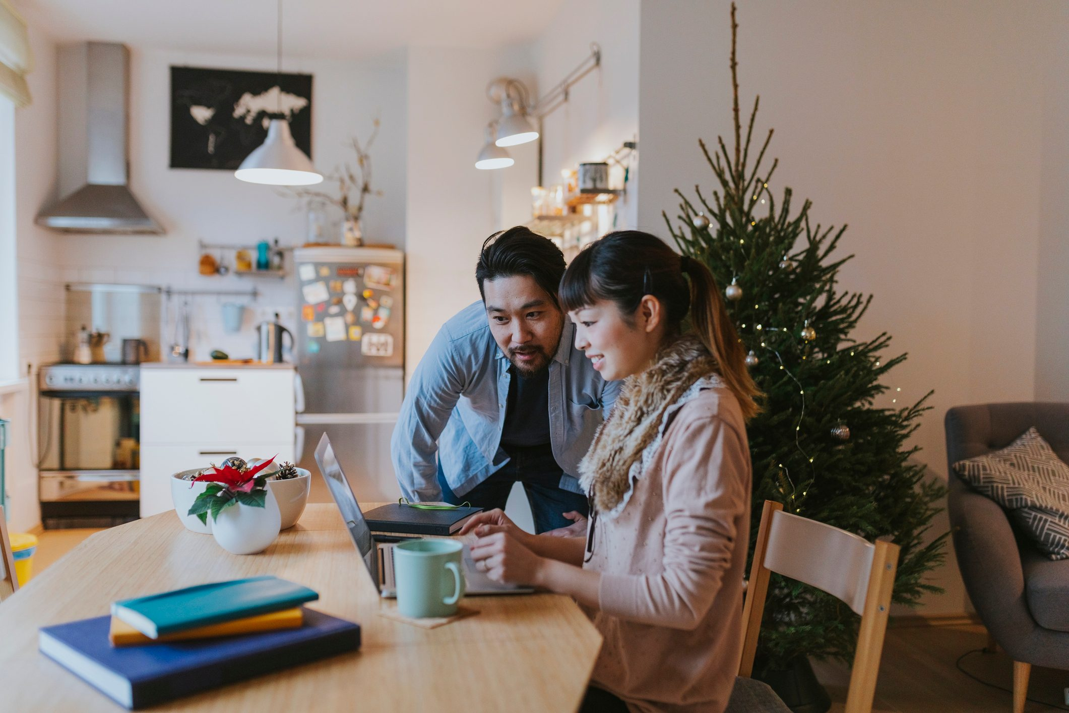 Japanese man and woman doing Christmas online shopping at home