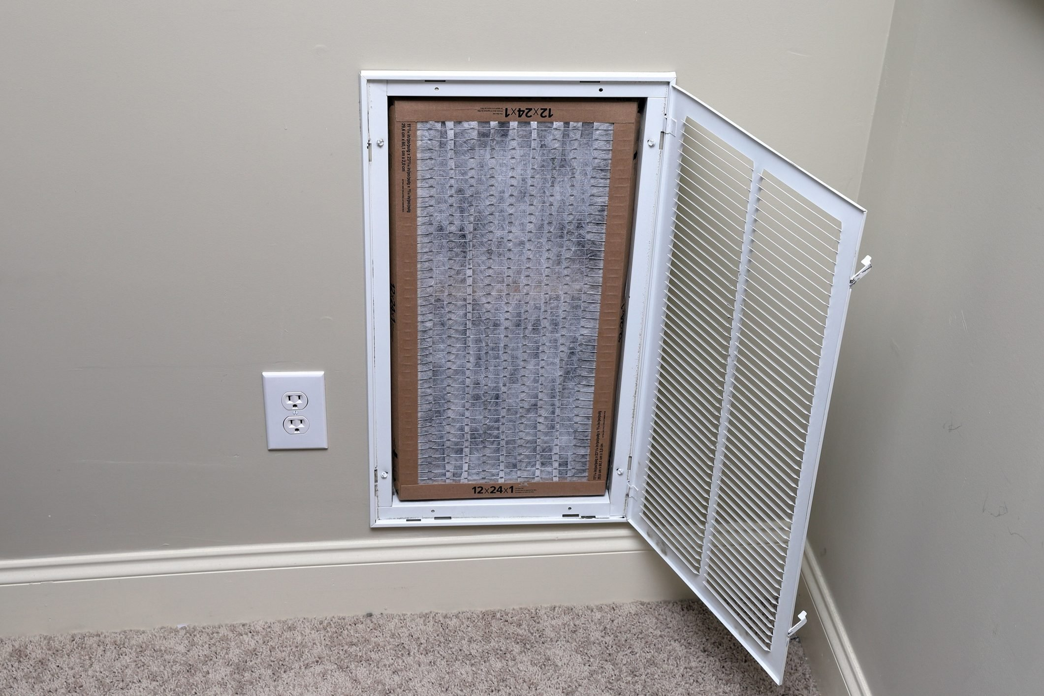 replacing clean air filter for air conditioner maintenance
