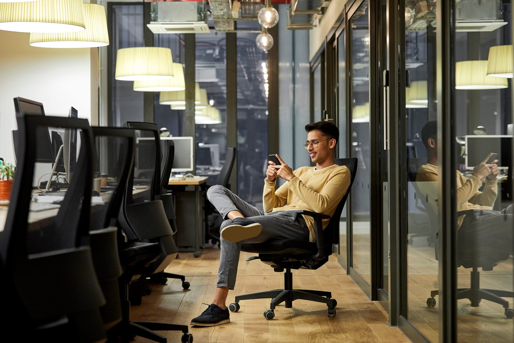 Businessman using mobile phone in creative office