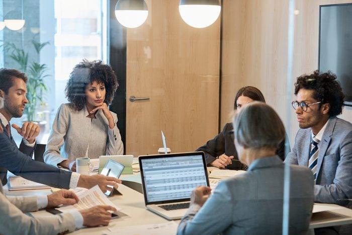 Multi-ethnic entrepreneurs sitting in board room