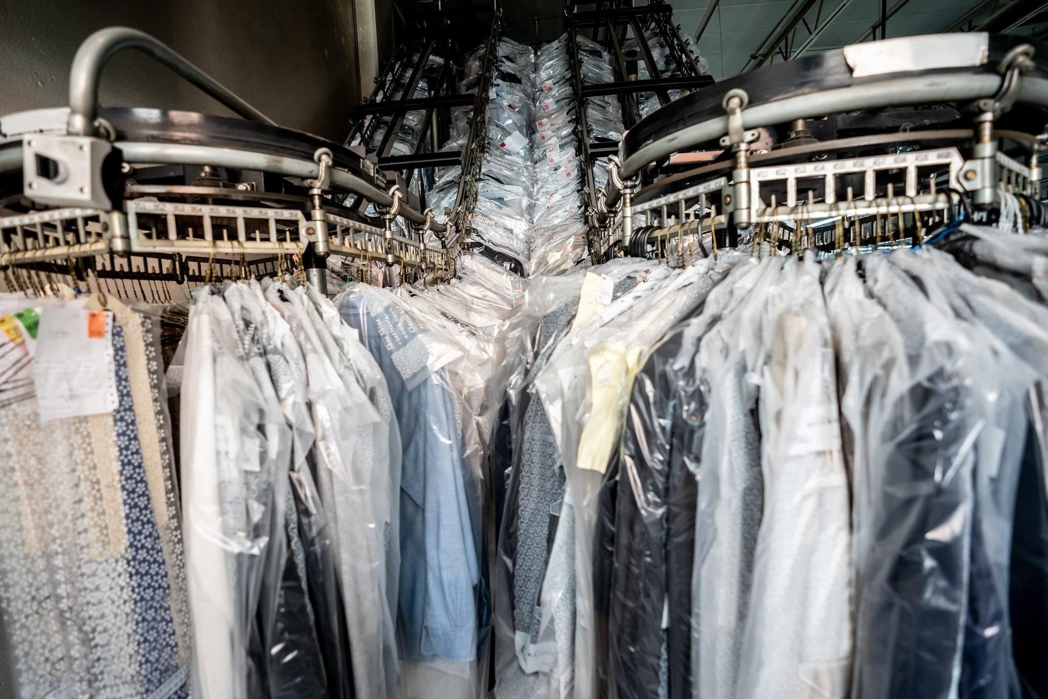 Conveyor belt at an industrial laundry service with clean clothes